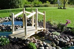 Cedar Creek Furniture manufactures custom hand-peeled 4' cedar log garden bridge.  Made from Michigan white cedar logs and lumber.