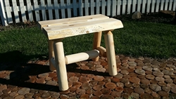 Rustic outdoor log bench