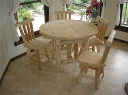 Rustic dining room table made of northern white cedar.  The top is made of dry kilned cedar lumber that is laminated together giving it a solid top.  Most rustic log dining room tables do not have a solid top.